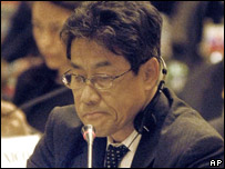 Japanese alternate commissioner to the International Whaling Commission Akira Nakamae grimaces while withdrawing his country's proposals for whale hunting in Japan (31 May 2007)