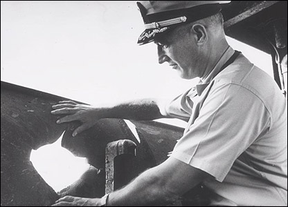 Capt William L McGonagle examines hole in ship (pic courtesy ussliberty.org)