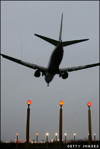 Aircraft landing at airport (Getty Images)