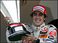 Double world champion Fernando Alonso celebrates victory in the Monaco Grand Prix