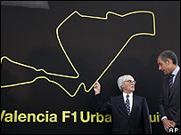 Formula One boss Bernie Ecclestone poses next to a map of the new Valencia Grand Prix track with Francisco Camps, president of the Valencian regional government