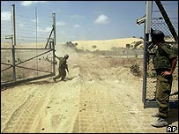 Israeli soldiers man the Gaza-Israel border fence