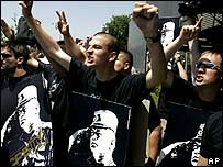 Serb nationalists chant slogans while holding placards depicting Ratko Mladic during a rally in Belgrade, Serbia, Saturday, May 26, 2007.