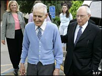 Jack Kevorkian (left) leaves prison accompanied by his lawyer (right)