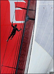 A member of Emirates Team New Zealand climbs the mast on the first day of sailing in the final of the Louis Vuitton Cup in Valencia, 01 June 2007