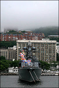 Vladivostok with a Russian warship in port