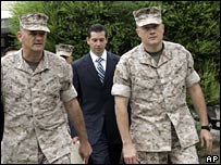 Lieutenant-Colonel Jeffrey Chessani (right) with his lawyers