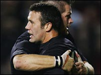 Aaron Mauger is congratulated by captain Richie McCaw after his first try