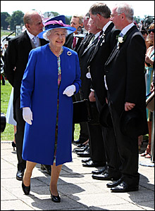 The Queen and the Duke of Edinburgh are greeted as they arrive at the racecourse