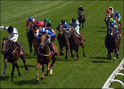 Richard Hills (blue and white striped hat) heads the field on Zaham