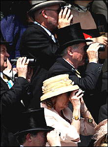 Racegoers watch from the main stand