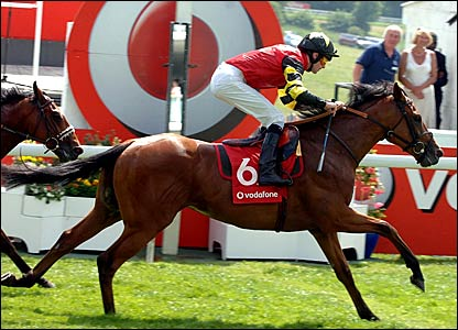 Declaration of War (l) wins the second race on the card