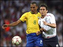 Gilberto Silva (left) battles with Lampard