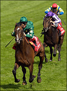 Frankie Dettori looks delighted as he wins the Derby on Authorized