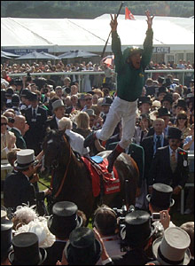 Franki Dettori jumps from the saddle