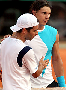 Rafael Nadal shakes hands with Albert Montanes