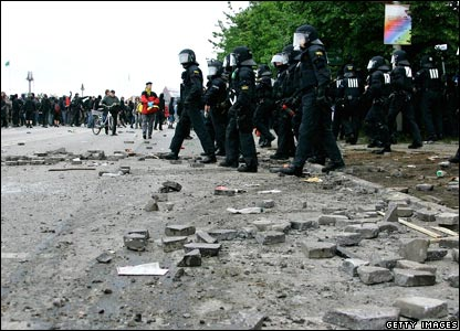Police standing near broken pavement