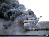 Sir Galahad on fire after being bombed on 8 June 1982