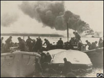 Injured troops being brought ashore during the Falklands