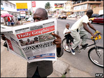 Man reads Ghana newspaper