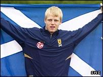 Steven Naismith flies the Scotland flag