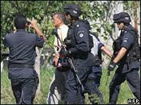 Rodrgio Granda (lefty) escorted by police
