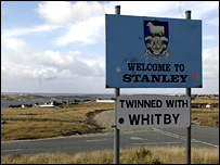"Sign saying ""Welcome to Stanley, twinned with Whitby"""