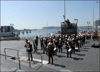 Bands and a 21-gun salute from HMS Exeter welcomed the Royal Family