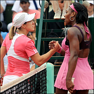 Justine Henin (left) shakes hands with Serena Williams