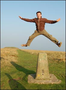 Rich vaulting the trig point on Twmbarlwm, as sent by Ian Morris from Newport