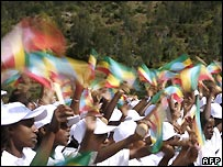 Ethiopian children wave the flag in Addis Ababa at a series of events in the run-up to the millennium celebration in September - 5/6/2007