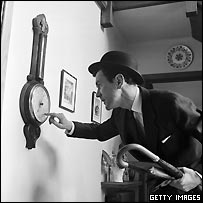 Businessman tapping barometer in 1954 (from Picture Post)