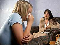 Actress modelling as rape victim and Pc Sharon Hancock, of South Yorkshire Police, in an interview room