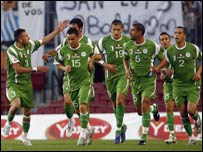 Algerian players celebrate a goal