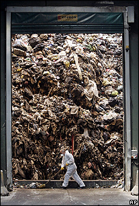 An employee works inside the Caivano dump, near Naples, southern Italy, where rubbish is turned into ecological bales