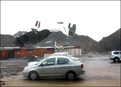 A building being torn apart in Muscat