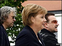 (left to right) Bob Geldof, Angela Merkel, Bono
