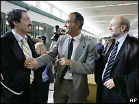 Defence lawyers, from left, Anselmo De Cataldo, Massimo Amoroso and Renato Borzone, react to jury's verdict