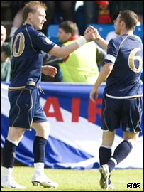 O'Connor (left) is congratulated by captain Barry Ferguson
