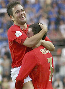Cole celebrates his goal with Wayne Bridge