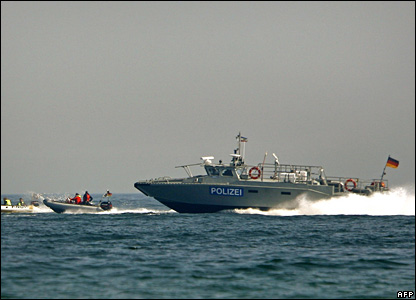Greenpeace boats are chased by coast guards on the sea near the beach of Kuehlungsborn