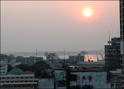 The sun setting over Kinshasa with Brazzaville visible over the River Congo