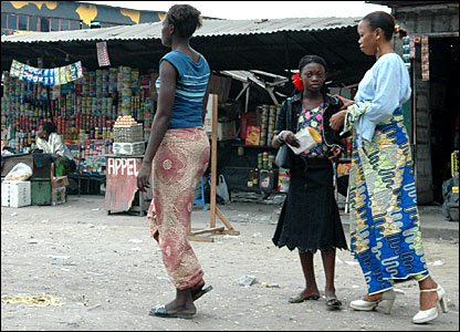 Women in front of a market stall in Kinshasa