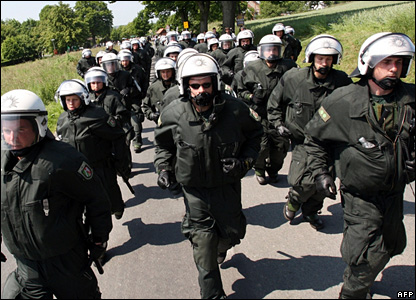 German riot police march in rows as anti-G8 activists block roads