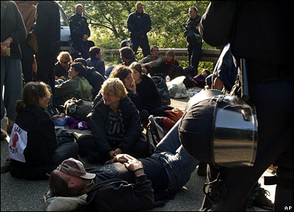 Anti-G8 protesters block a road near the summit