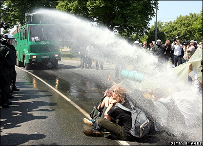 "Activists of the anti-G8 forum. ""Block G8"" are hit by police water cannon"