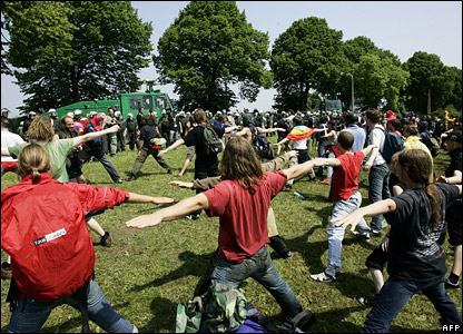 Anti-G8 protestors practice yoga during a demonstration near Heiligendamm