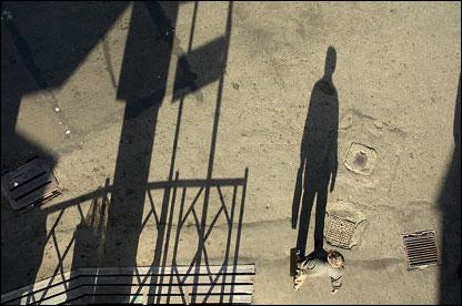 Long shadows cast as a man walks along Saadi Street.