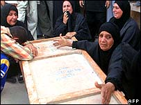 Women mourn their relative killed in Qurna