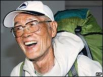 Katsusuke Yanagisawa of Japan returns to Narita airport, east of Tokyo, Thursday, May 31, 2007